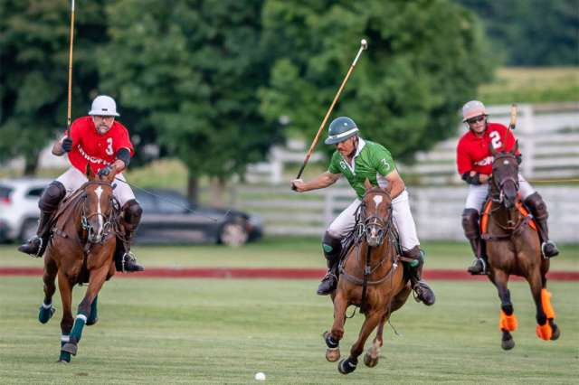 Dean Kleronomos of Morgan Creek Farm chasing after Billy Mudra riding Thing 2 in the Chicago Polo 4-6 goal league.©John Sterndish