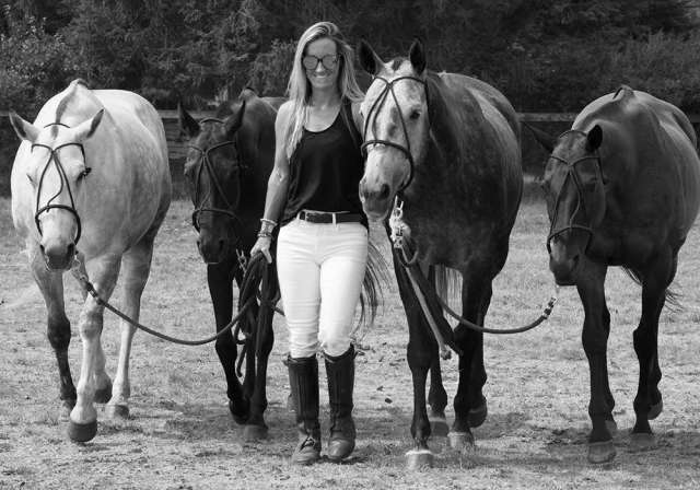 Sheryl leading polo horses