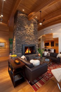 Floor to ceiling stone fireplace with roof beams