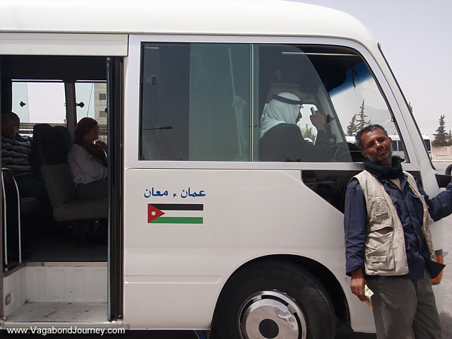taxi assistant poses outside the minibus