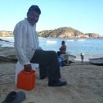 Mezcal vendor with liquor in gas cans