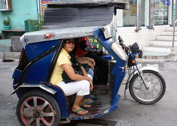 Passengers are crammed into tricycles