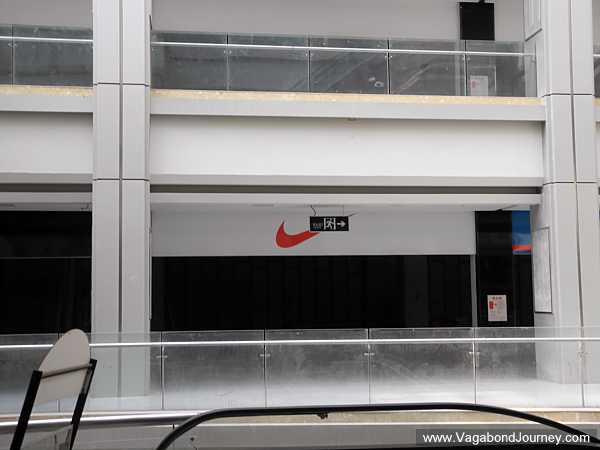 Fake Nike sign above vacant store