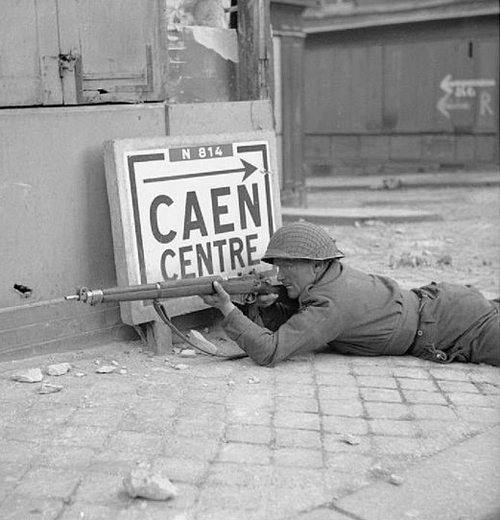 A British Army sniper in Caen, Normandy during the Second World War By Sergeant Christie No 5 Army Film & Photographic Unit [Public domain], via Wikimedia Commons