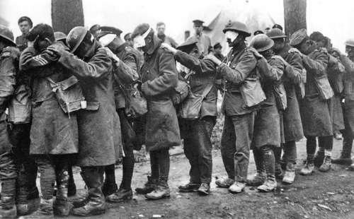 British 55th (West Lancashire) Division troops blinded by tear gas await treatment at an Advanced Dressing Station near Bethune during the Battle of Estaires, 10 April 1918, part of the German offensive in Flanders By Thomas Keith Aitken (Second Lieutenant) [Public domain], via Wikimedia Commons
