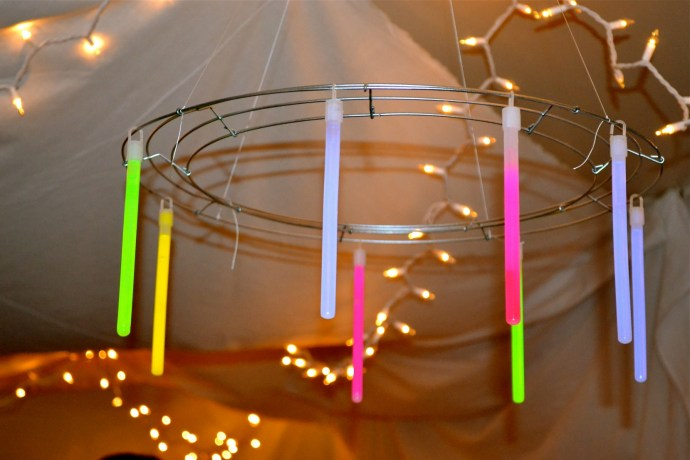 Diy glow stick chandelier valley magazine love with the glow stick chandeliers we made for our hunger games themed throw a party with a few supplies and just four steps you can make your own aloadofball Image collections