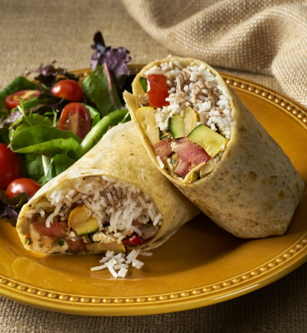 Vegetarian Sandwich Wrap or burrito made up of saute yellow squash, zucchini, bell peppers and onions rolled in a corn tortilla with rice and diced tomatoes and goat cheese and drizzled with a balsamic vinaigrette. Wrap is served with a baby lettuce salad.