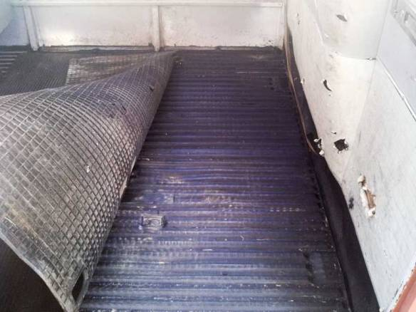 cargo floor treated with a protective top coat of POR 15 high performance rust-preventive coating