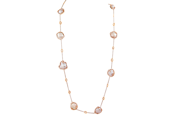 Aurelle's mother of pearl necklace crafted in pink and rose gold.