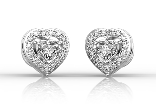 Heart shaped diamond-studded earrings in white gold from ilovediamonds.com