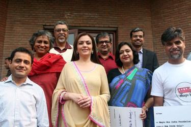 Nita Ambani with Vivek Anand, Anjali Gopalan and other volunteers