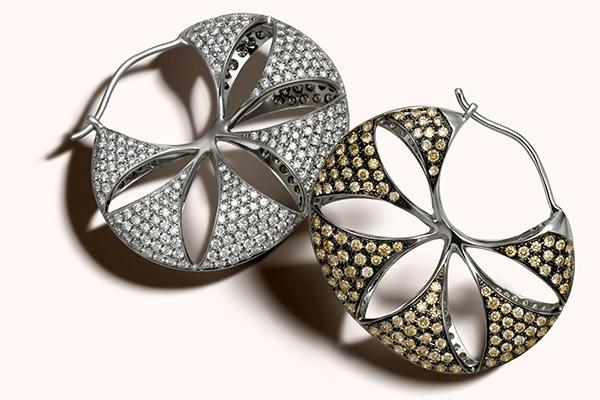 Zoya Espana earrings with white and champagne diamonds set in rhodium.