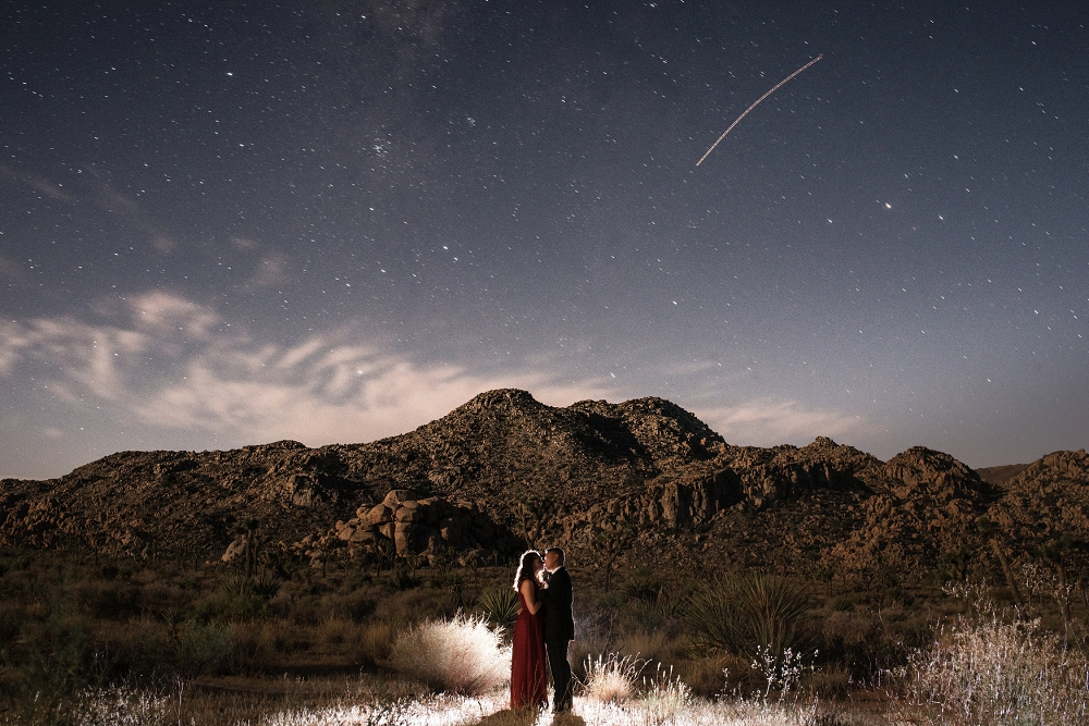 Night couple portrait in Joshua Tree done by an orange county wedding photographer