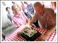 Lolo Ave, trying to blow the candles on his cake
