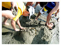 classmates burrying Raf under the sand
