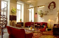Burggasse24 caf: The living room caf with couches and a ...