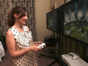 Actress Kelly Macdonald, who voices lead character Merida for Disney-Pixar's upcoming film Brave and Brave: The Video Game, plays the game at a recent event in Scotland. (Photo: Business Wire)
