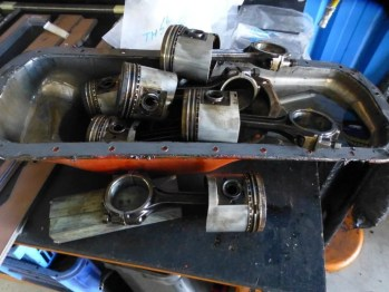 The pistons are all set to go to the bin because the block has to be rebored and new oversize pistons and rings fitted.