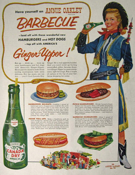 Original vintage magazine ad for Canada Dry Ginger Ale featuring Annie Oakley