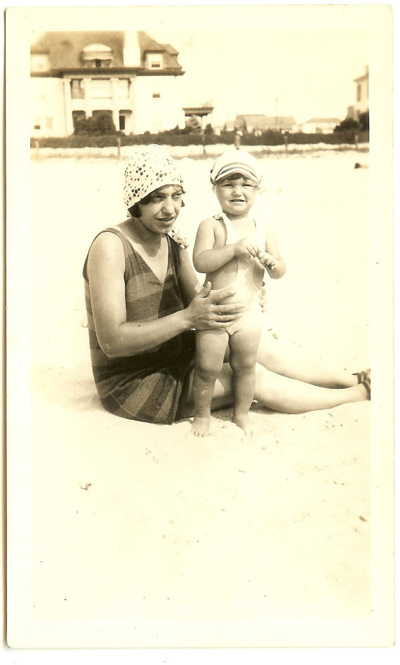 1920s vintage photo of mom and child in swimsuits at beach