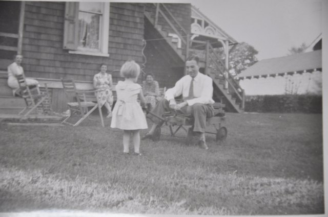 Lovely family photograph with a little girl and her daddy, circa 1940's/1950's