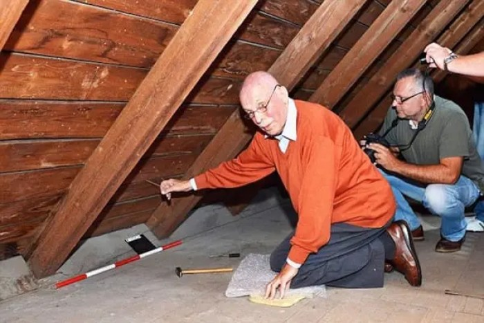 """Pic shows: Rudi Schlattner in the attics. This is the moment an elderly man was temporarily reunited with family property that had been hidden when he was a 13-years-old and his family were evicted in one of largest mass expulsions the world has ever seen. Rudi Schlattner was forced to flee the family casa that had been built by his merchant father after the end of World War II as part of a mass expulsion of Germans from Czechoslovakia after World War II. The destruction of World War II had caused enormous hatred in Czechoslovakia of its ethnic German population, and the government under Czechoslovak President Edvard Benes ordered the """"final solution of the German question"""" by evicting all ethnic Germans from the country. Thousands died during the forced expulsions of 1.6 million ethnic Germans their homes and into the American zone West Germany. These were the fortunate ones, and a further 800,000 were sent to the Soviet zone. Rudi and his family were among those that ended up in the American zone, and before they left they had time to hide their property in the attic of the family home. He said """"We thought we would one day return, and that would find a property there."""" Now in his 80s, he realised that this would now never happen and has now returned to make sure that even if he is not allowed to have the family property back, at least it will not be forgotten and wanted to make sure people understood who it 11 belonged to and why it was there. He contacted municipal officials in the village of Libouch in north-western Czech Republic who used the family casa now as a kindergarten, and where it was a revelation that the items had been hidden in the roof of the refurbishments carried out including the roof. But Rudi's father had done such a good job of hiding it, that nobody had discovered them. He said: """"My father built the villa in 1928 and 1929. He always thought that one day we would return and get it back."""" He was accompanied on the visit to the building by empl"""