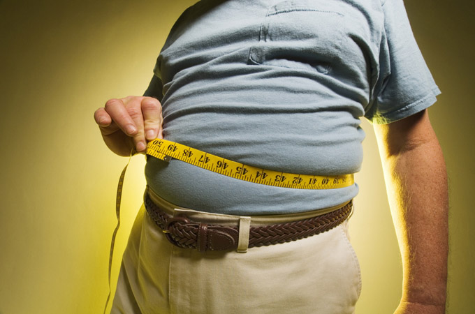 Man measuring his waist