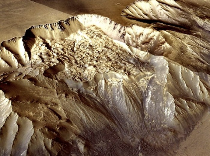 Fig 3. A 40 km long landslide in Valles Marineres at latitude -9.982, longitude -69.609. The very high albedo and visual appearance is suggestive of a not inconsiderable amount of water ice. (ESA/DLR/FU Berlin; G.Neukum)