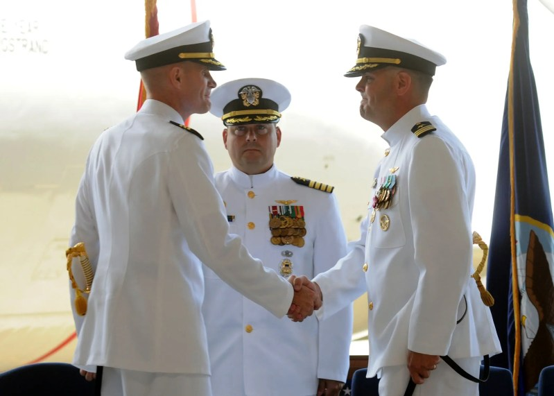Commanding Officer Brent Strong relieves outgoing Commanding Officer Skipper Kevin Long in front of Commodore Christopher Ramsden.  Photo taken by MC1 Nathan Laird.
