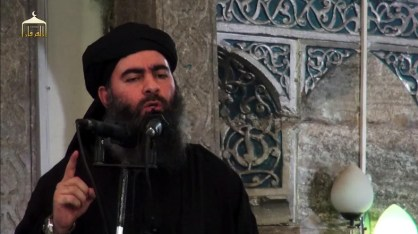 "An image grab taken from a propaganda video released on July 5, 2014 by al-Furqan Media allegedly shows the leader of the Islamic State (IS) jihadist group, Abu Bakr al-Baghdadi, aka Caliph Ibrahim, adressing Muslim worshippers at a mosque in the militant-held northern Iraqi city of Mosul. Baghdadi, who on June 29 proclaimed a ""caliphate"" straddling Syria and Iraq, purportedly ordered all Muslims to obey him in the video released on social media.    AFP PHOTO / HO / AL-FURQAN MEDIA  == RESTRICTED TO EDITORIAL USE - MANDATORY CREDIT ""AFP PHOTO / HO / AL-FURQAN MEDIA "" - NO MARKETING NO ADVERTISING CAMPAIGNS - DISTRIBUTED AS A SERVICE TO CLIENTS FROM ALTERNATIVE SOURCES, AFP IS NOT RESPONSIBLE FOR ANY DIGITAL ALTERATIONS TO THE PICTURE'S EDITORIAL CONTENT, DATE AND LOCATION WHICH CANNOT BE INDEPENDENTLY VERIFIED == / AFP PHOTO / AL-FURQAN MEDIA / -"