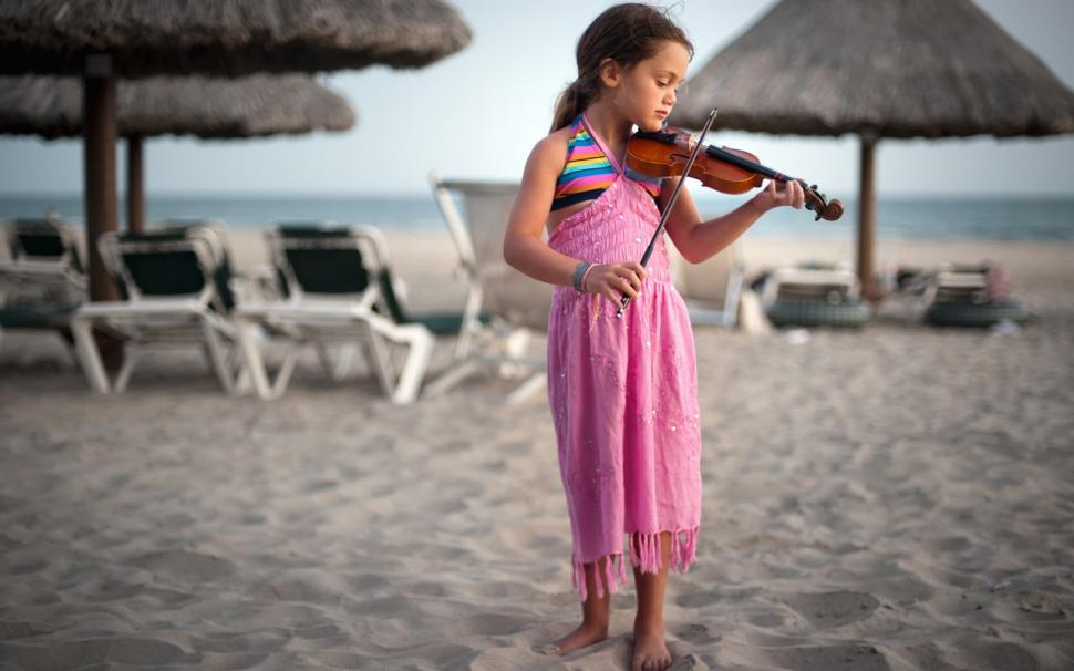 Cute Punjabi Girl Wallpaper Download Cute Little Girl At The Beach Playing A Violin Wallpaper