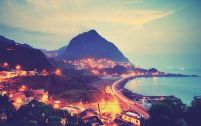 City in front of mountain beside the ocean during dusk HD wallpaper | Wallpaper Flare