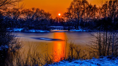 Sunset In Winter Snow River Coast Two Sun Orange Sky Reflection In Water Beautiful Scenario ...