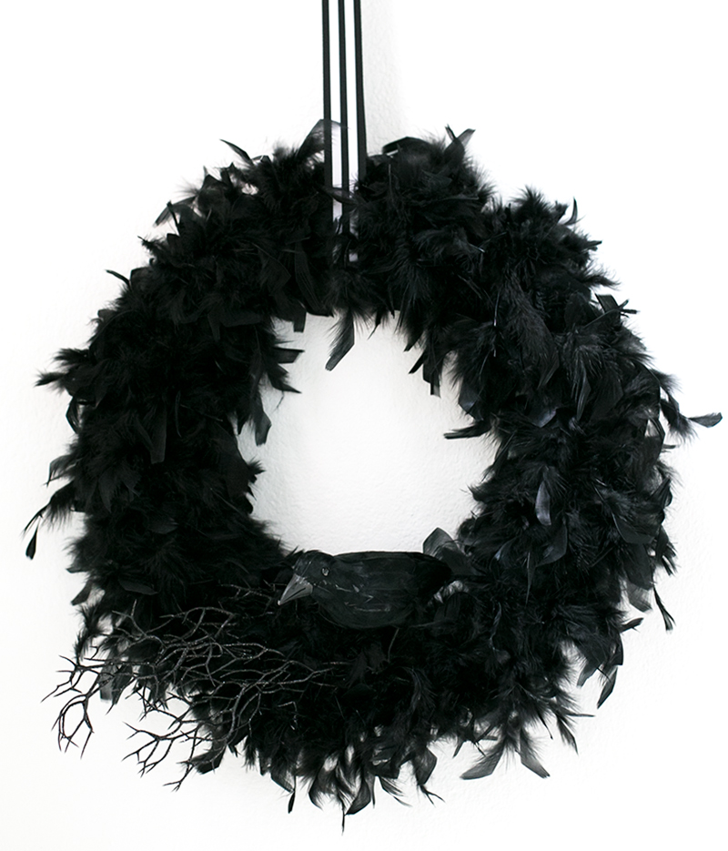 Create this modern raven-themed wreath for Halloween. So simple.