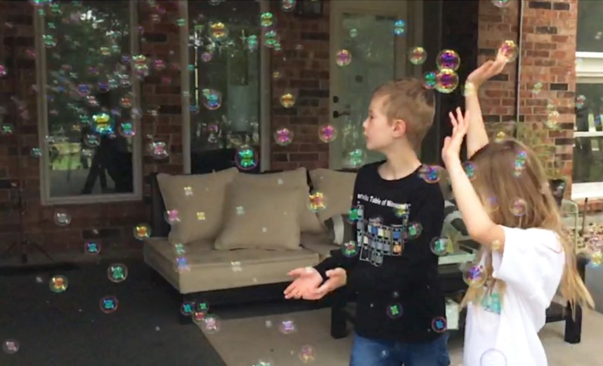 bubble machine blowing bubbles