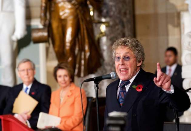 The Who's Roger Daltrey performs in Statuary Hall on Capitol Hill in Washington, Wednesday, Oct. 30, 2013, during a ceremony to dedicate a bust of Winston Churchill. Senate and House leaders, as well as Secretary of State John Kerry, gathered on Wednesday to dedicate the Churchill bust, which will now stand in the Capitol as a testament to the strength of the relationship between the US and the United Kingdom. Senate Minority Leader Mitch McConnell of Ky. and House Minority Leader Nancy Pelosi of Calif. watch at left. (AP/Molly Riley)