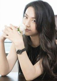 l'actrice chinoise Tang Wei avec montre Rado Ceramic Diamaster Noire