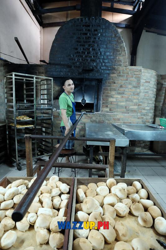 "Loading the ""pugon"" (brick oven)"