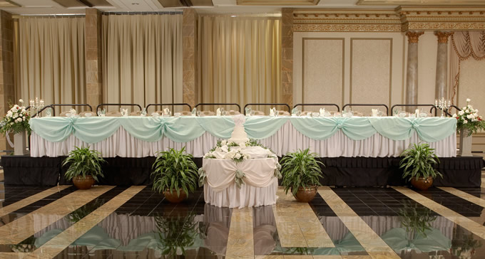 Head table layout and decorations - - wedding reception setup with rectangular tables