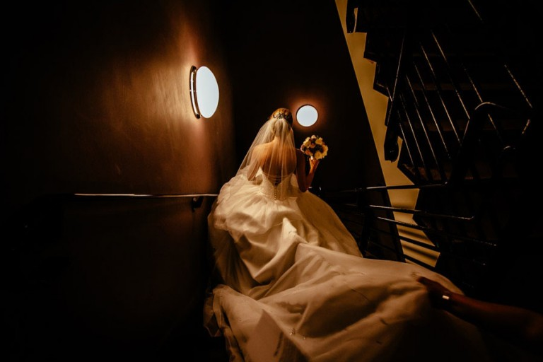 Bride walking down stairs