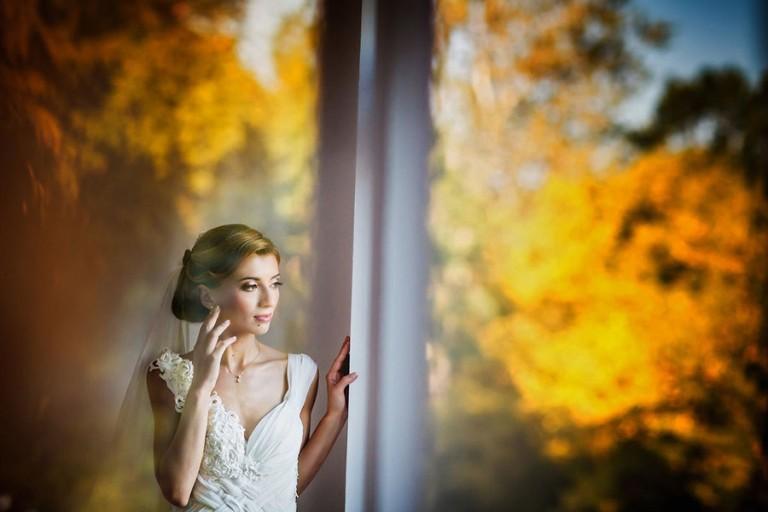 Bride posing for wedding photograph