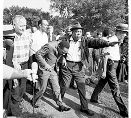 Martin Luther King after being hit by a rock during a demonstration in Chicago, 1966