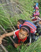 Cliff climb school children China
