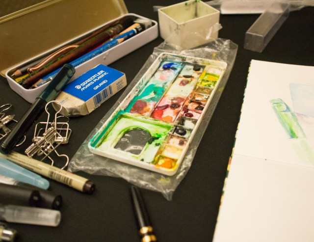 Juliavdw worked on some watercolors for a traveling sketchbook at the letter writing social.