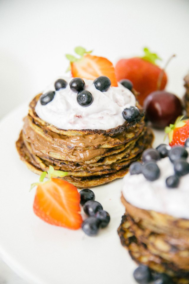 Small pancake cakes with chocolate, berries and coconut cream