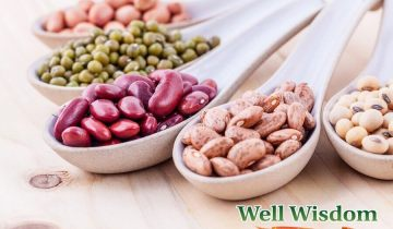 Assortment of beans and lentils in wooden spoon on wooden background. mung bean groundnut soybean red kidney bean black bean red bean and brown pinto beans .