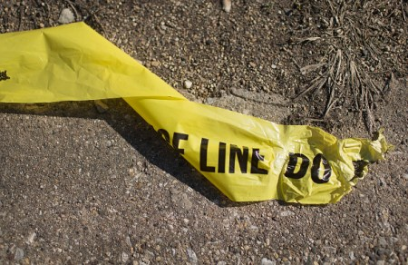 """CHICAGO, ILLINOIS - APRIL 12:  Remnants of crime scene tape lay on the ground near the spot where 16-year-old Pierre Loury was shot yesterday by a Chicago police officer on April 12, 2016 in Chicago, Illinois. Police have said Loury took off running when the vehicle he was in was pulled over by police because it matched the description of a vehicle used in an earlier drive-by shooting. The chase, according to police, ended with an """"armed confrontation"""".  (Photo by Scott Olson/Getty Images)"""