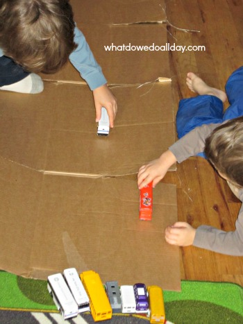 Use a cardboard box to make a toy car road