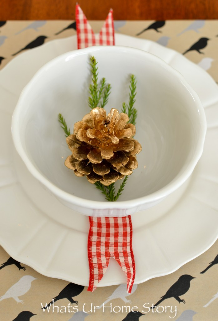 Simple Christmas place setting with pine cones