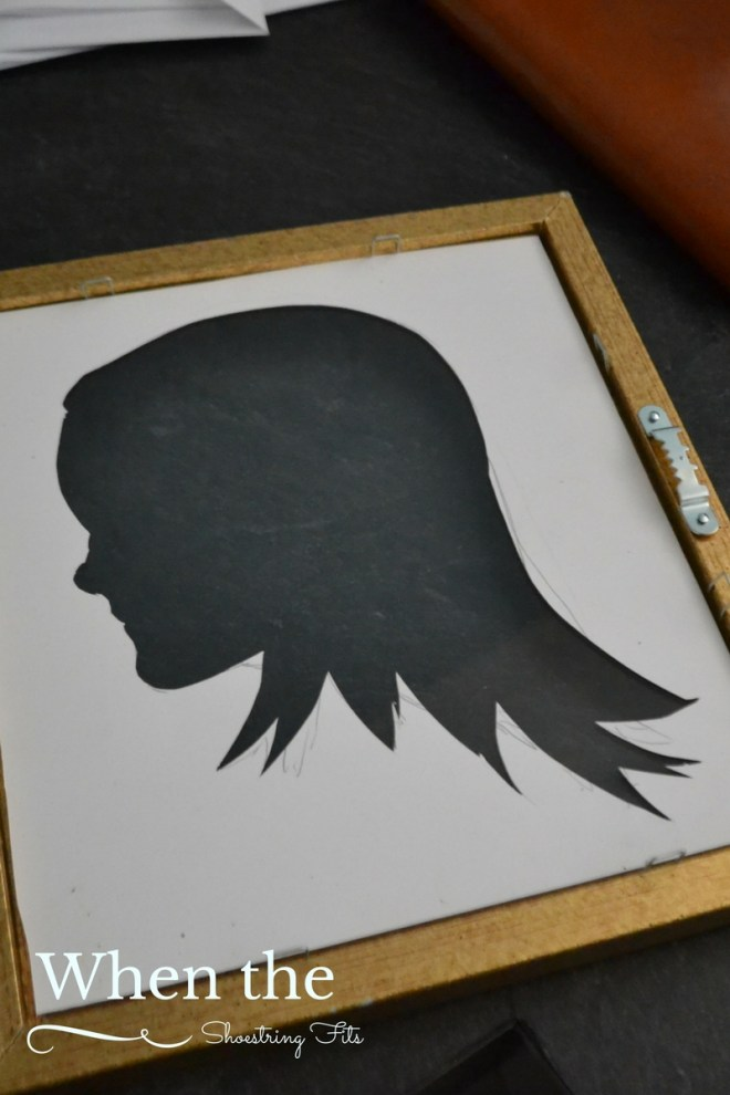 Place silhouette cut out in the frame with the pencil outline at the back where it wont be seen.